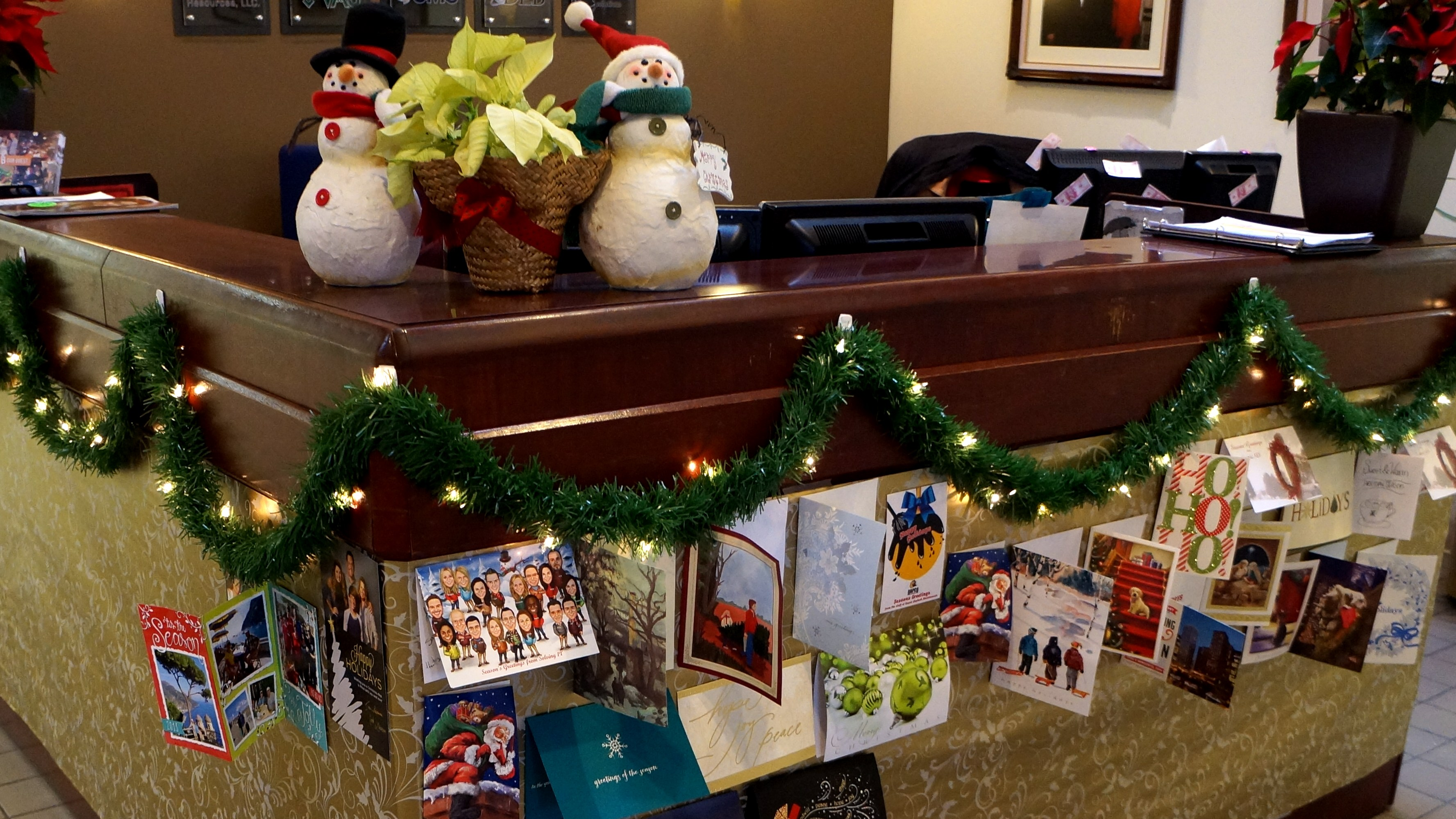 Holiday Cards Decorate The Front Desk